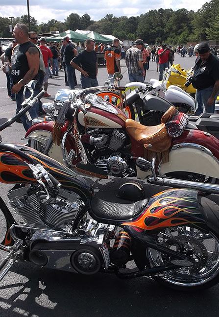custom bikes lined up at a motorcycle show